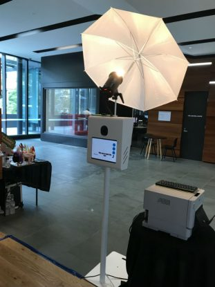 Photo booth set up at a corporate event showing touch screen